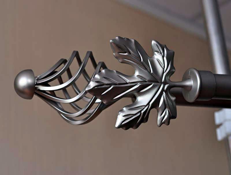 кованый карниз с декором в виде листьев