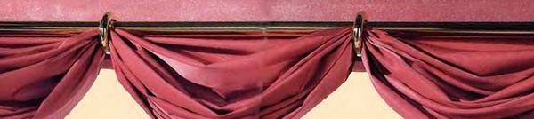 перекинутые шторы на кольцах