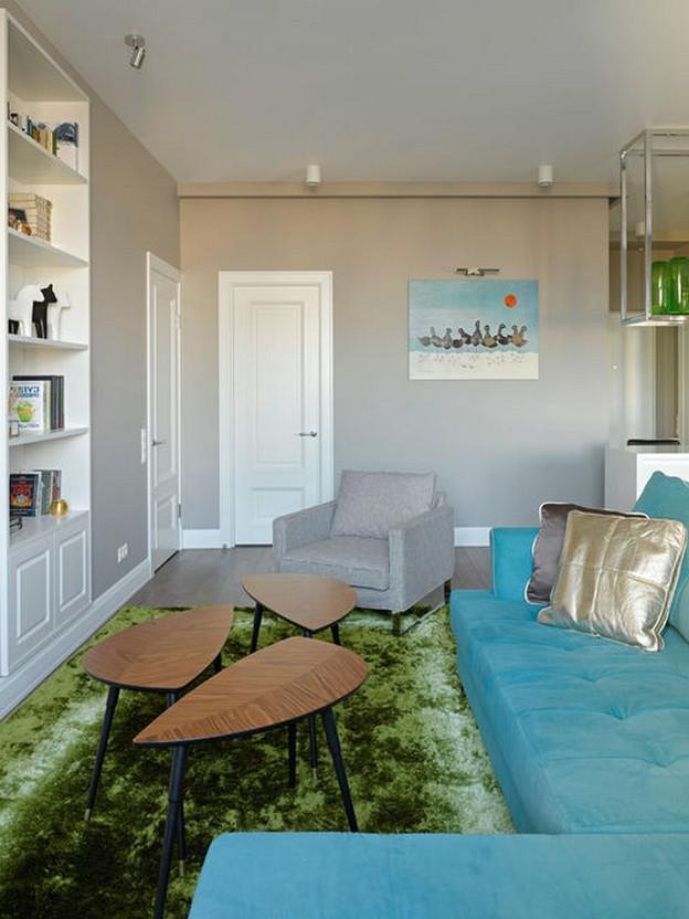 бирюзовый диван и зеленый ковер