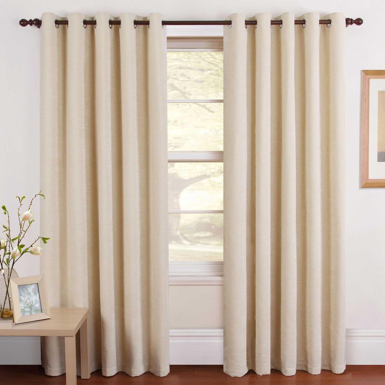 кремовые шторы на портьере с люверсами